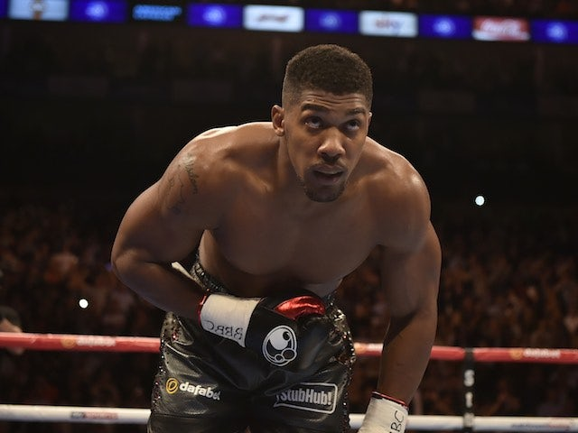 Anthony Joshua takes a bow after sparking out Gary Cornish on September 12, 2015