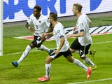 Austria's David Alaba (L) celebrates scoring a penalty with his team-mates Martin Harnik (C) and Marc Janko (R) during the Euro 2016 qualifying group G football match between Sweden and Austria at the Friends Arena in Solna, near Stockholm on September 8,