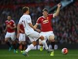 Man Utd's Bastian Schweinsteiger closes down Lucas Leiva of Liverpool on September 12, 2015