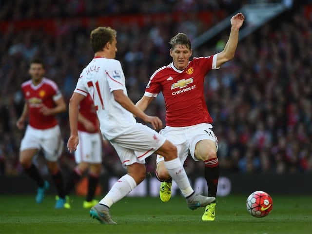 Man Utd's Bastian Schweinsteiger closes down Lucas Leiva of Liverpool on September 12, 2015