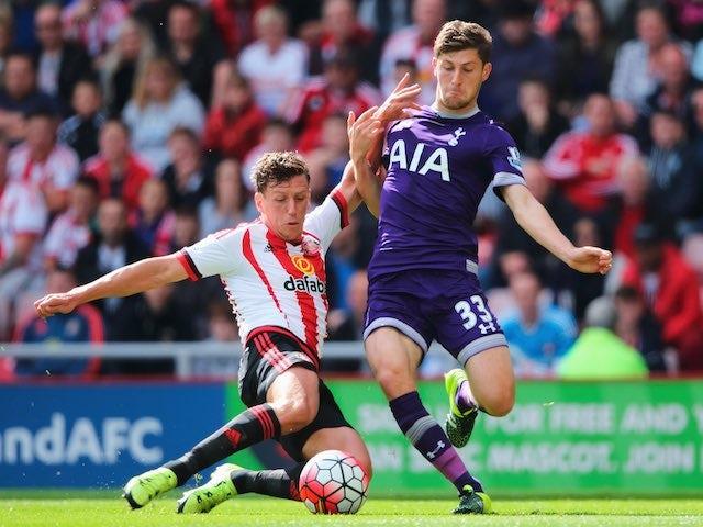 Sunderland's Billy Jones tackles Ben Davies of Spurs on September 13, 2015
