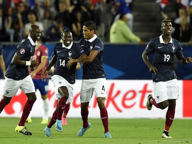 France's midfielder Blaise Matuidi (C) celebrates with France's defender Raphael Varane (2nd R) after scoring during the Euro 2016 friendly football match France vs Serbia at the Matmut Atlantique stadium in Bordeaux on September 7, 2015.