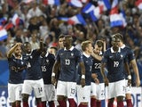 France's midfielder Blaise Matuidi (2nd L) celerates with his teammates after scoring his second goal during the Euro 2016 friendly football match France vs Serbia at the stadium in Bordeaux on September 7, 2015.