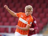 Brad Potts of Blackpool attempts to control the ball during the Capital One Cup First Round match between Northampton Town and Blackpool at Sixfields Stadium on August 11, 2015