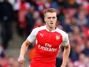 Calum Chambers of Arsenal runs with the ball during the Emirates Cup match between Arsenal and VfL Wolfsburg at the Emirates Stadium on July 26, 2015