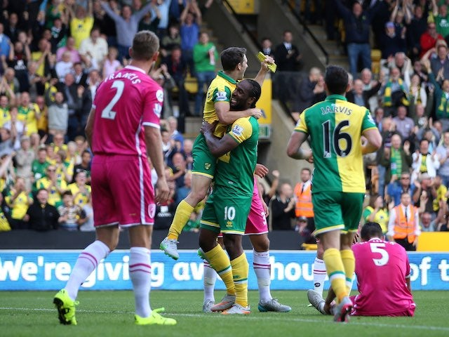 Cameron Jerome celebrates scoring the opener for Norwich against Bournemouth on September 12, 2015