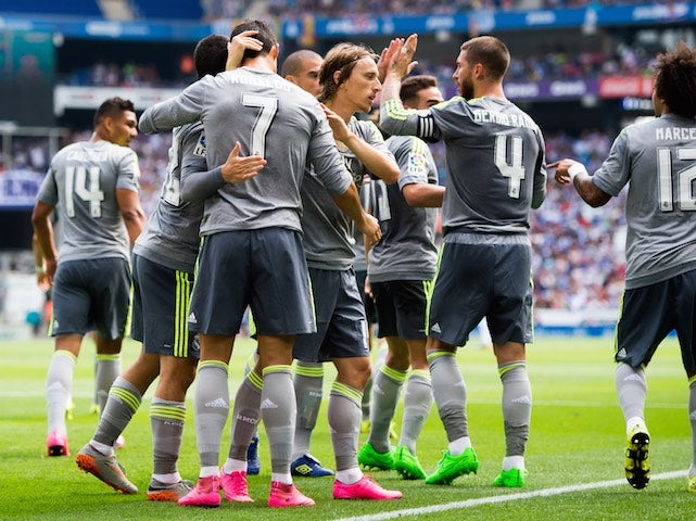 Cristiano Ronaldo is congratulated by Real Madrid teammates after scoring past Espanyol on September 12, 2015