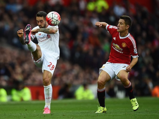 Liverpool's Danny Ings and Man Utd's Ander Herrera in action on September 12, 2015