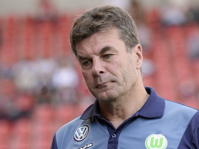 Wolfsburg coach Dieter Hecking arrives for his team's game with Ingolstadt on September 12, 2015