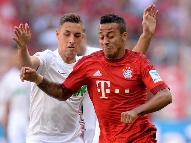 Augsburg's Dominik Kohr battles with Thiago Alcantara of Bayern on September 12, 2015