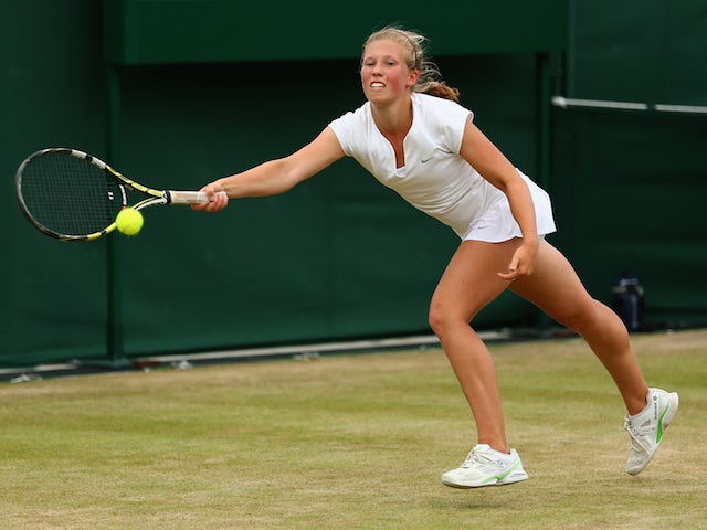 Emily Arbuthnott of Great Britain plays a forehand in her Girl's Singles First Round match against Olivia Tjandramulia of Australia during day seven of the Wimbledon Lawn Tennis Championships at the All England Lawn Tennis and Croquet Club on July 6, 2015