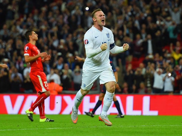 Wayne Rooney of England celebrates scoring their second goal from the penalty spot during the UEFA EURO 2016 Group E qualifying match between England and Switzerland at Wembley Stadium on September 8, 2015