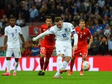 Wayne Rooney of England scores their second goal from the penalty spot during the UEFA EURO 2016 Group E qualifying match between England and Switzerland at Wembley Stadium on September 8, 2015