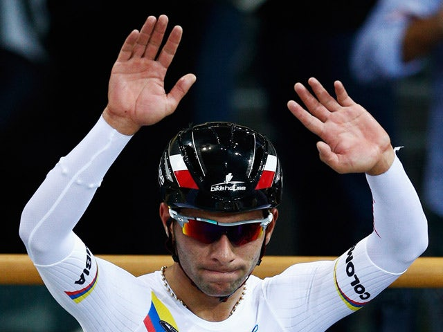 rnando Gaviria of Colombia celebrates winning the gold medal in the Men's Omnium during day 4 of the UCI Track Cycling World Championships held at National Velodrome on February 21, 2015