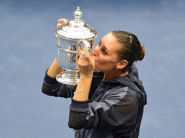 Flavia Pennetta kisses her US Open trophy after defeating Roberta Vinci on September 12, 2015