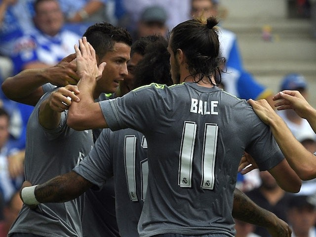 Gareth Bale congratulates Cristiano Ronaldo during the game between Real Madrid and Espanyol on September 12, 2015