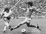 West German forward Gerd Muller (L) scores the second goal for his team despite the being pressured by Dutch defender Rudi Krol, 07 July 1974 in Munich, during the World Soccer Cup final. West Germany defeated the Netherlands 2-1.