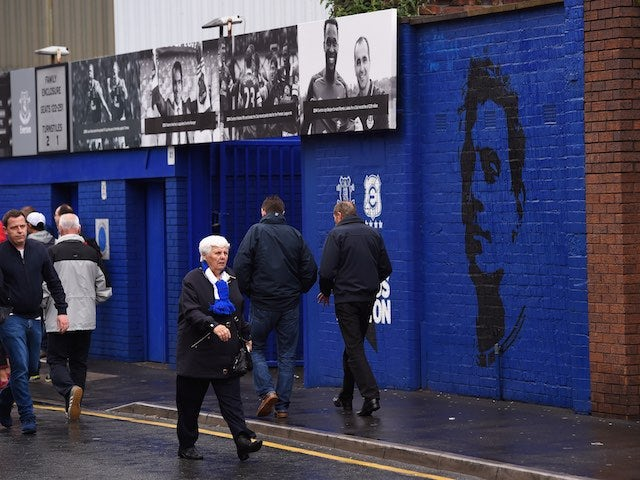 Fans arrive at Goodison Park ahead of the early kickoff between Everton and Chelsea on September 12, 2015