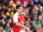 Hector Bellerin of Arsenal runs with the ball during the Emirates Cup match between Arsenal and VfL Wolfsburg at the Emirates Stadium on July 26, 2015
