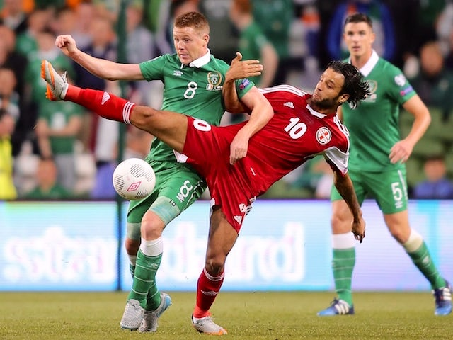 Republic of Ireland's midfielder James McCarthy (L) vies with Georgia's midfielder Tornike Okriashvili during the Euro 2016 qualifying group D football match between Republic of Ireland and Georgia at Aviva Stadium in Dublin on September 7, 2015