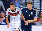 Jonas Hector of Germany is closed down by James Forrest of Scotland during the UEFA EURO 2016 Qualifier Group D match between Scotland and Germany at Hampden Park on September 7, 2015 in Glasgow, Scotland.