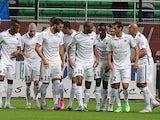 Caen players celebrate after Julien Feret grabs the opener against Troyes on September 12, 2015