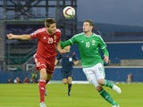 Kyle Lafferty (R) of Northern Ireland and Richard Guzmics (L) of Hungary in action during the Euro 2016 Group F qualifying match at Windsor Park on September 7, 2015 in Belfast, Northern Ireland.