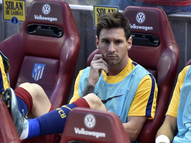 Lionel Messi watches on from the bench as Barcelona take on Atletico Madrid on September 12, 2015