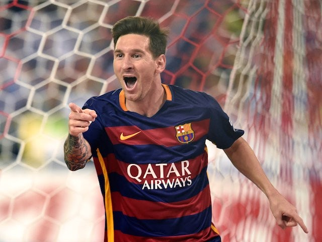 Lionel Messi celebrates scoring to put Barcelona 2-1 up over Atletico Madrid on September 12, 2015