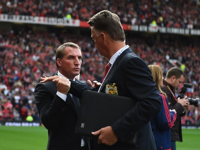 Louis van Gaal and Brendan Rodgers exchange a weird handshake prior to the game between Manchester United and Liverpool on September 12, 2015