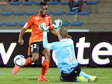 Angers keeper Ludovic Butelle attempts to distract Lorient's Benjamin Moukandjo with jazz hands on September 12, 2015