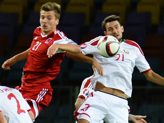 Luxembourg's forward Maurice Deville (L) jumps for the ball with Belarus' defender Yegor Filipenko during the Euro 2016 qualifying football match between Belarus and Luxembourg in Borisov, outside Minsk, on September 8, 2015