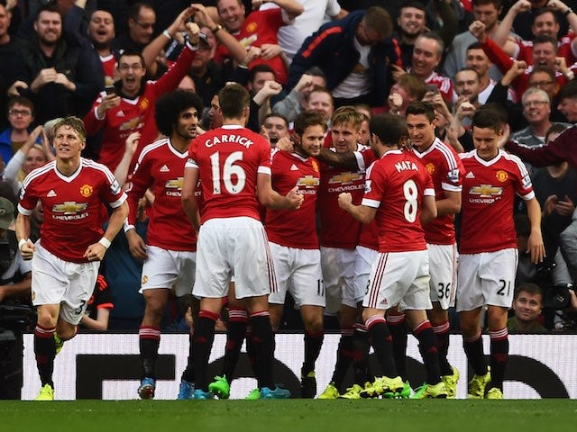 Man Utd players celebrate after Daley Blind gets the breakthrough against Liverpool on September 12, 2015