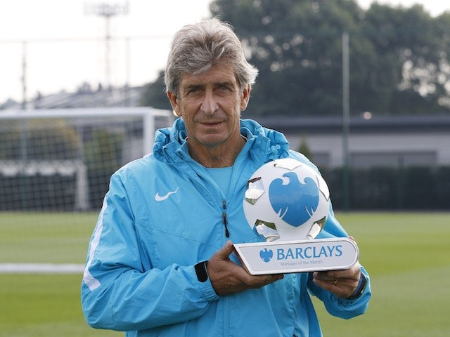 Silver fox Manuel Pellegrini poses proudly with his Manager of the Month award for August 2015