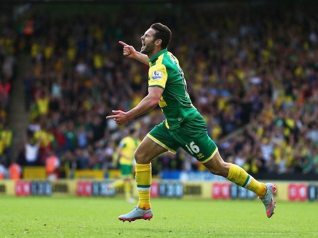 Matt Jarvis celebrates scoring Norwich's third against Bournemouth on September 12, 2015