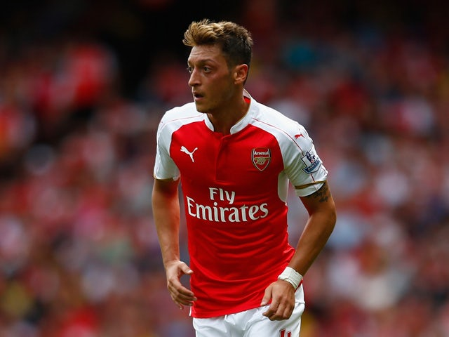 Mesut Ozil of Arsenal in action during the Barclays Premier League match between Arsenal and West Ham United at the Emirates Stadium on August 9, 2015