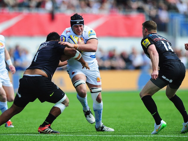 Mitch Lees of Exeter Chiefs is tackled by Mako Vunipola of Saracens during the Aviva Premiership match between Saracens and Exeter Chiefs at Allianz Park on May 10, 2015 in Barnet, England.