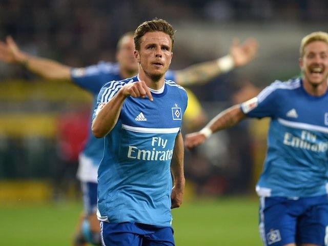 Nicolai Muller celebrates scoring for Hamburg against Borussia Monchengladbach on September 11, 2015