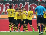 Pierre-Emerick Aubameyang is congratulated by teammates after scoring Dortmund's equaliser against Hannover on September 12, 2015