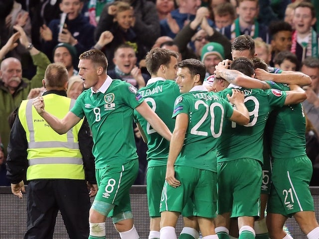 Republic of Ireland's players celebrate their first goal during the Euro 2016 qualifying group D football match between Republic of Ireland and Georgia at Aviva Stadium in Dublin on September 7, 2015.