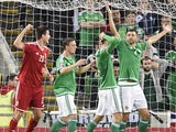 Hungary's defender Richard Guzmics (L) celebrates scoring the opening goal of the Euro 2016 qualifying group F football match between Northern Ireland and Hungary at Windsor Park in Belfast on September 7, 2015.