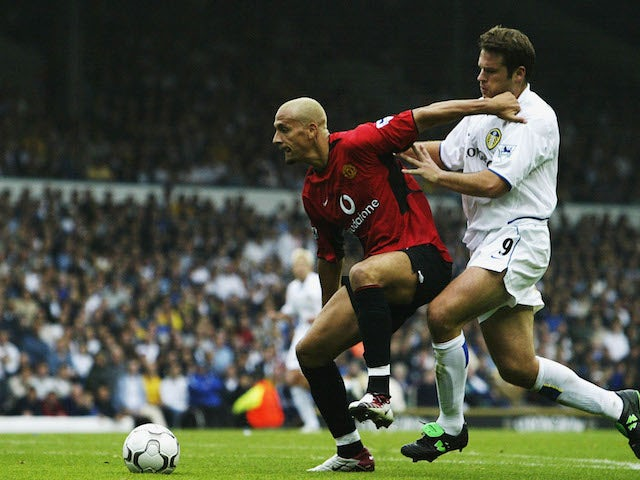 Rio Ferdinand of Manchester United battles for the ball with Mark Viduka of Leeds during the FA Barclaycard Premiership game between Leeds United and Manchester United at Elland Road in Leeds, England on September14 , 2002.