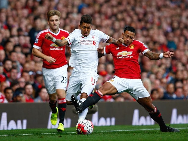 Liverpool's Roberto Firmino and Man Utd's Memphis Depay tussle on September 12, 2015