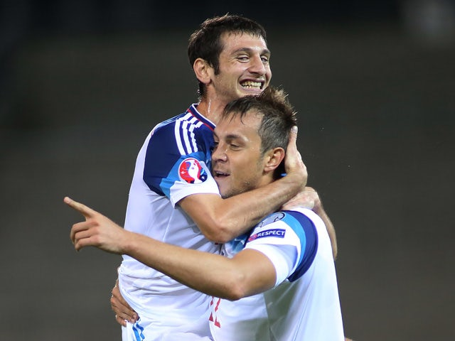 Russias Artem Dzyuba (R) celebrate with his teammate Alan Dzagoev after scoring during the Euro 2016 qualifying football match between Liechtenstein and Russia at the Rheintal stadium in Vaduz on September 8, 2015