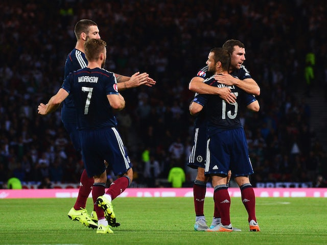 Shaun Maloney of Scotland celebrates the own goal scored by Mats Hummels of Germany with team mates during the UEFA EURO 2016 Qualifier Group D match between Scotland and Germany at Hampden Park on September 7, 2015 in Glasgow, Scotland.