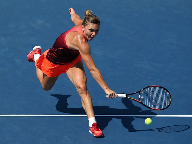 Simona Halep of Romania returns a shot against Sabine Lisicki of Germany during their Women's Singles Fourth Round match on Day Eight of the 2015 US Open at the USTA Billie Jean King National Tennis Center on September 7, 2015 in the Flushing neighborhood