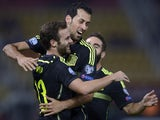 Spain's Midfielder Juan Mata (L) celebrates with his teammate midfielder Sergio Busquets (C) after scoring during the Euro 2016 Group C qualifying football match between Macedonia and Spain at the Filip II Arena stadium in Skopje on September 8, 2015
