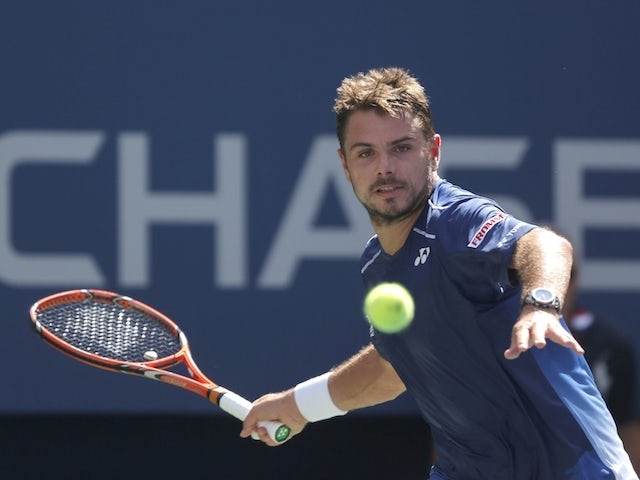Stan Wawrinka of Switzerland returns a shot to Donald Young of the US during their 2015 US Open Men's Singles round 4 match at the USTA Billie Jean King National Tennis Center September 7, 2015 in New York.