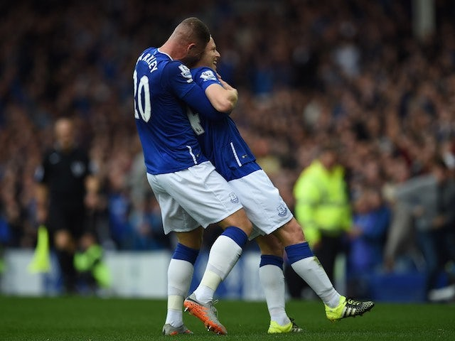 Steven Naismith is congratulated by teammate Ross Barkley after scoring Everton's second against Chelsea on September 12, 2015