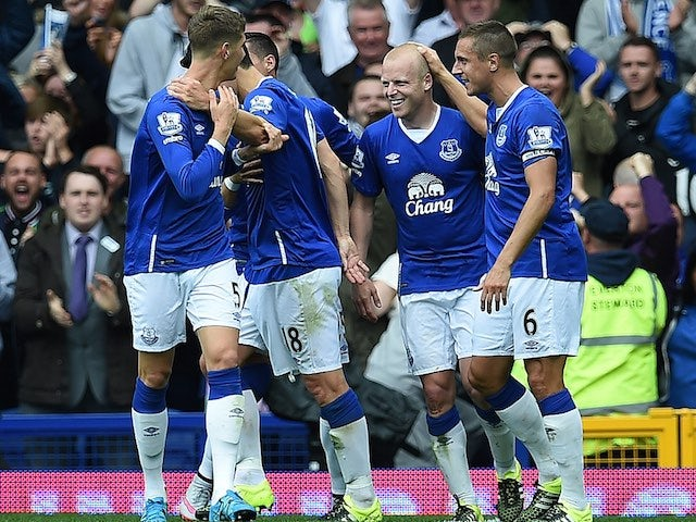 Steven Naismith is congratulated by teammates after he completes his hat-trick against Chelsea on September 12, 2015